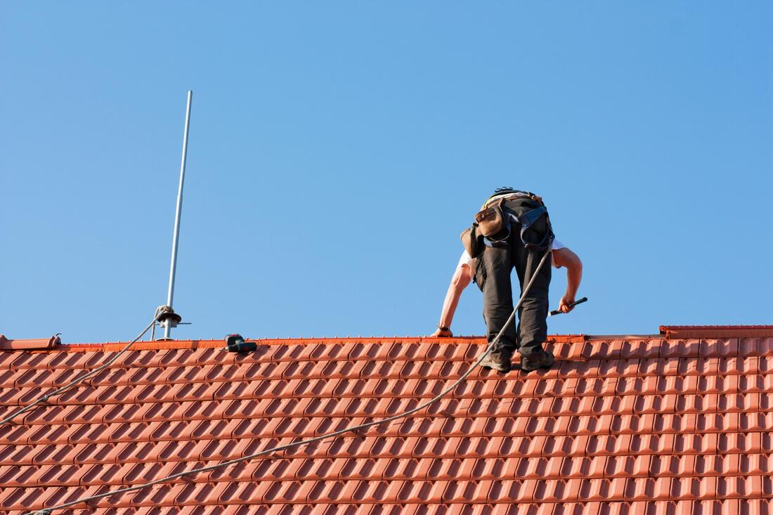 professional roofer working on residential roofing